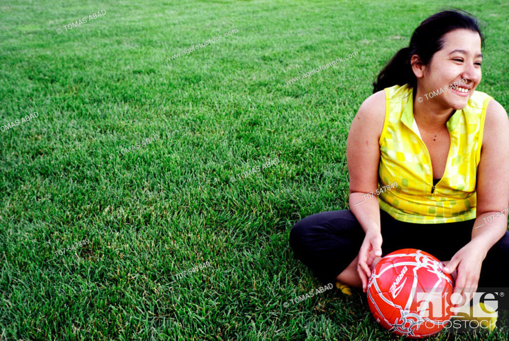 Imagen: Latino woman holding soccer ball - football.