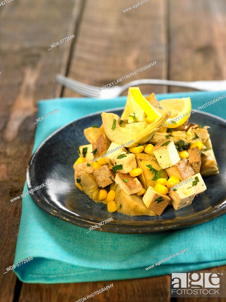Stock Photo: sautéed artichokes with smoked tofu.