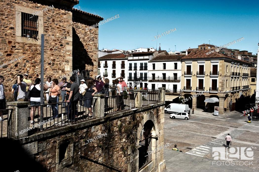 Stock Photo: group of tourists in the old town. Caceres, Spain.