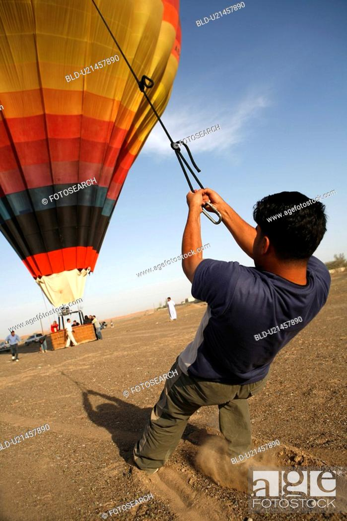 Stock Photo: dubai, baloon, holding.