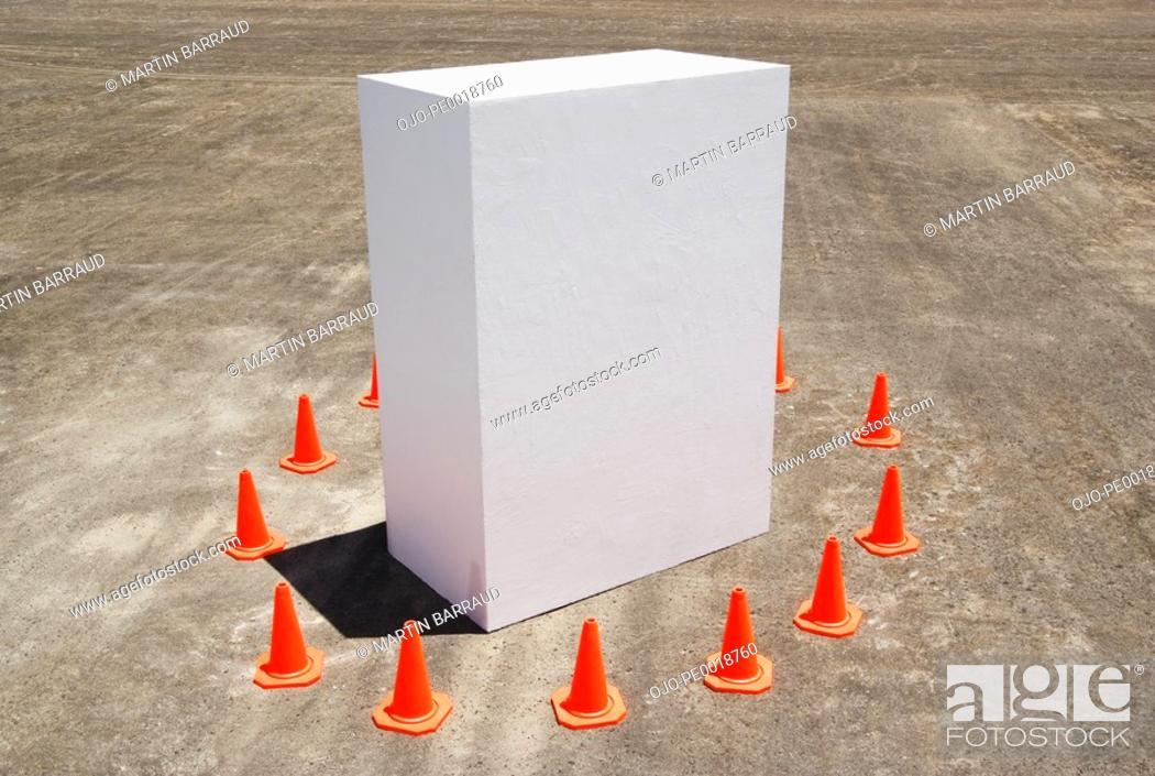 Stock Photo: Traffic cones around white box.