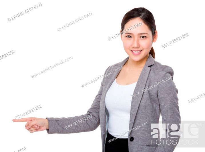 Stock Photo: Young Businesswoman showing finger point aside.
