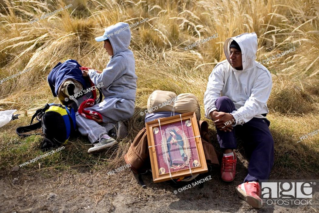 Stock Photo: Pilgrims rest in a field as they travel to reach the Basilica of Guadalupe in Mexico City, December 7, 2008  Hundreds of thousands of Mexican pilgrims converged.