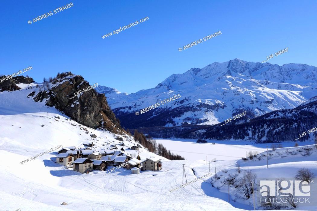 Stock Photo: Village Grevasalvas with snow-covered lake Silser See, Piz Grevasalvas, Albula range, Upper Engadin, Engadin, Grisons, Switzerland, Europe.