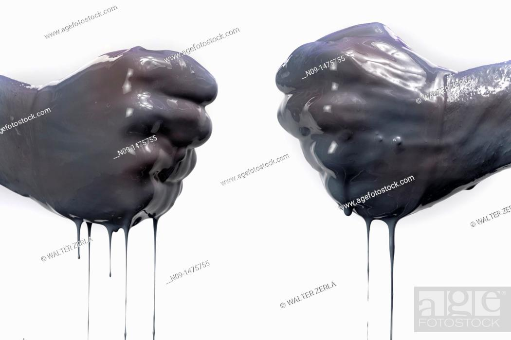 Stock Photo: two fists with dark liquid.