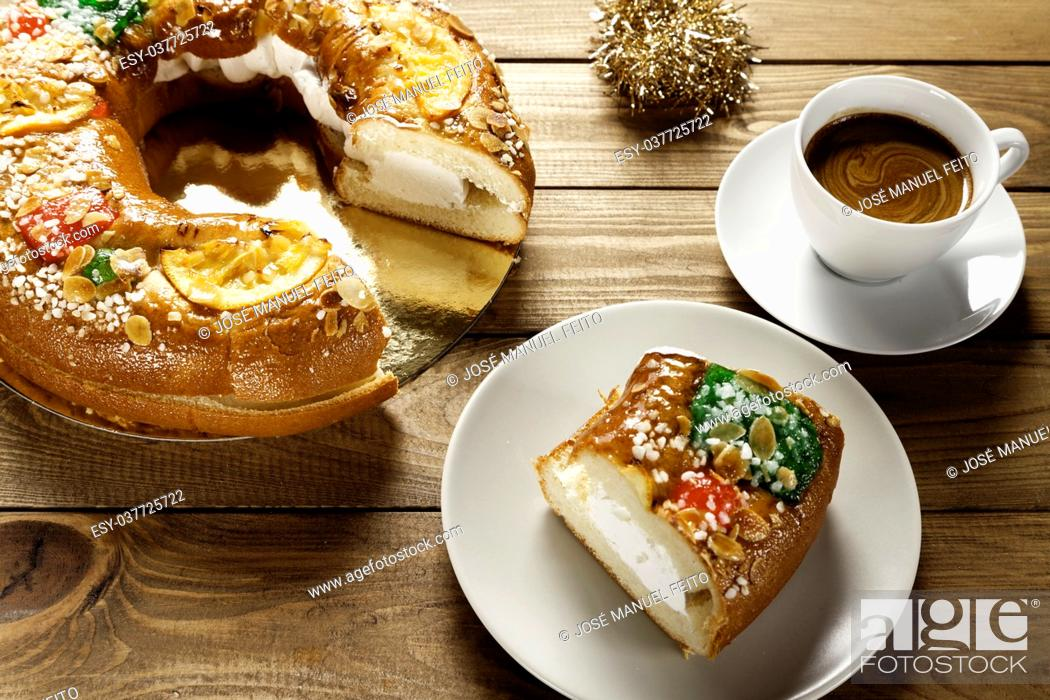 Stock Photo: piece of epiphany cake on a plate with a cup of coffee on wood table.