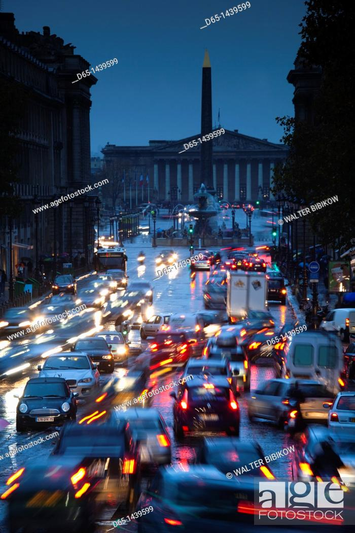 Stock Photo: France, Paris, elevated view of evening traffic on rue Royale from Eglise Madeleine church.