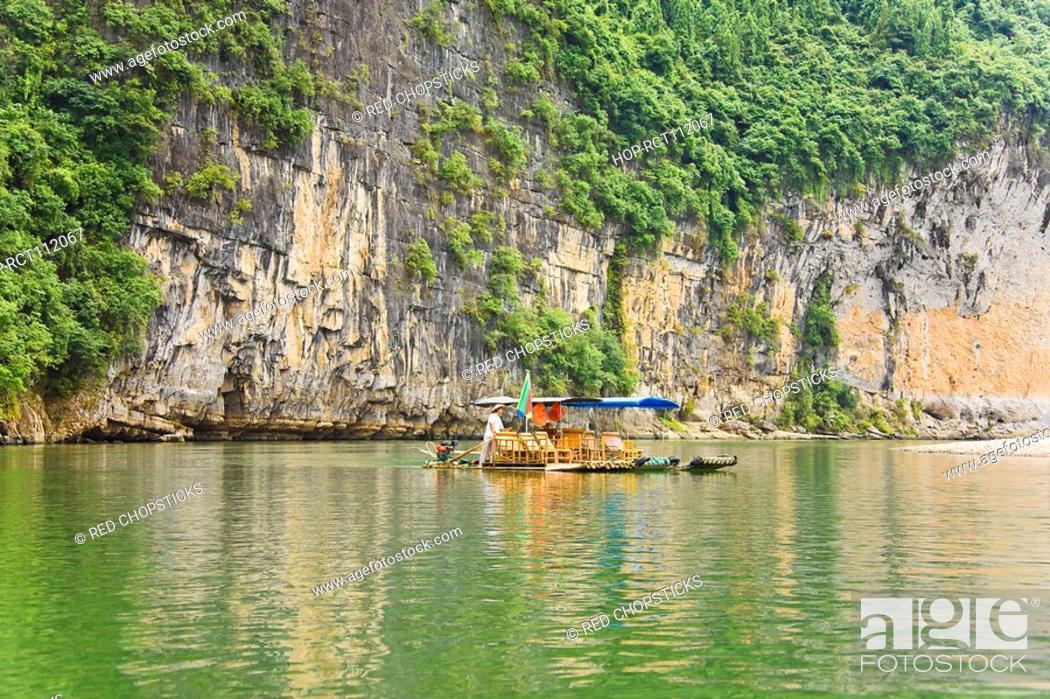 Stock Photo: Boats in a river, XingPing, Yangshuo, Guangxi Province, China.
