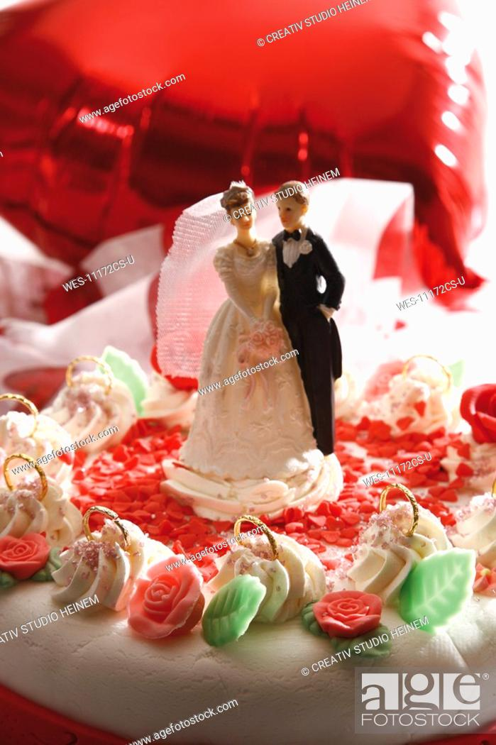 Stock Photo: Wedding cake topper with bride and groom.