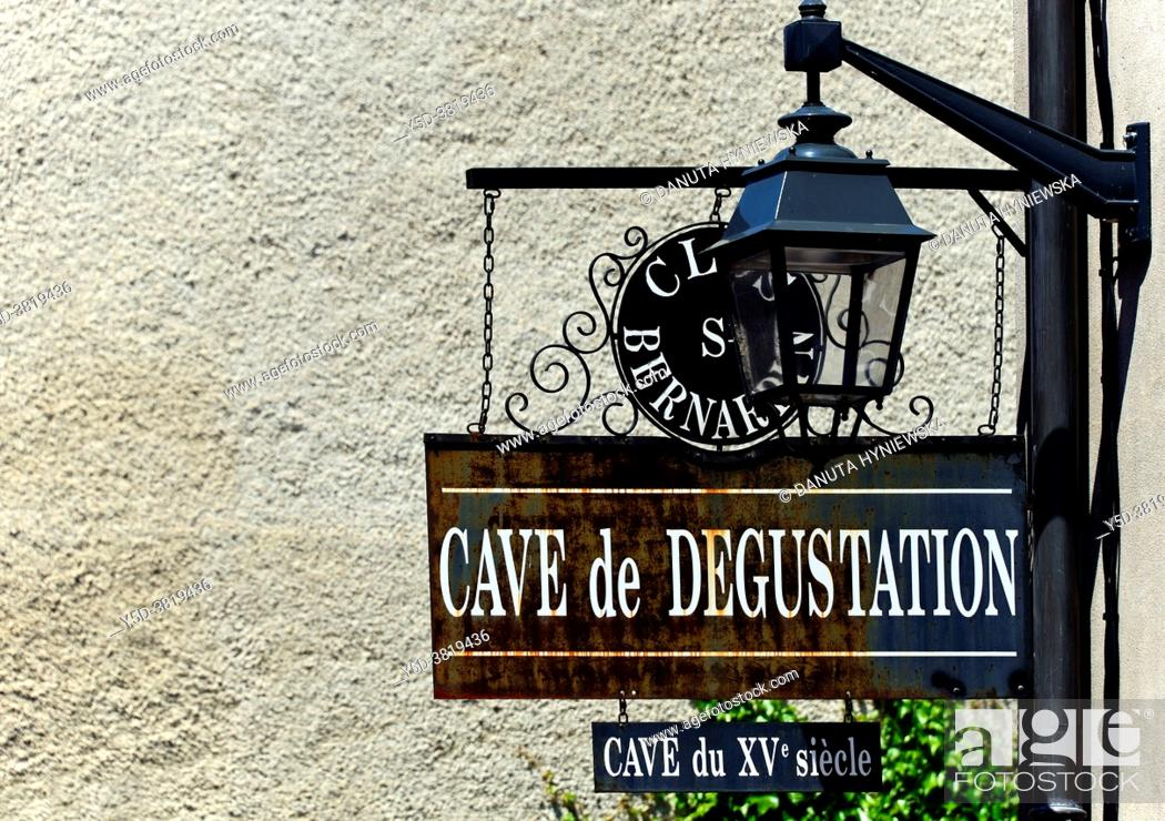 Stock Photo: Winery sign - inviting for degustation of wines from XV century caves, Beaune - capital of Burgundy, Department of Cote d'Or, Burgundy, France, Europe.