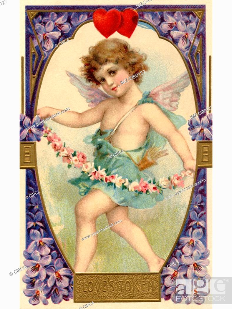Stock Photo: A vintage Loves Token Valentine card with a cherubim holding a flower garland.