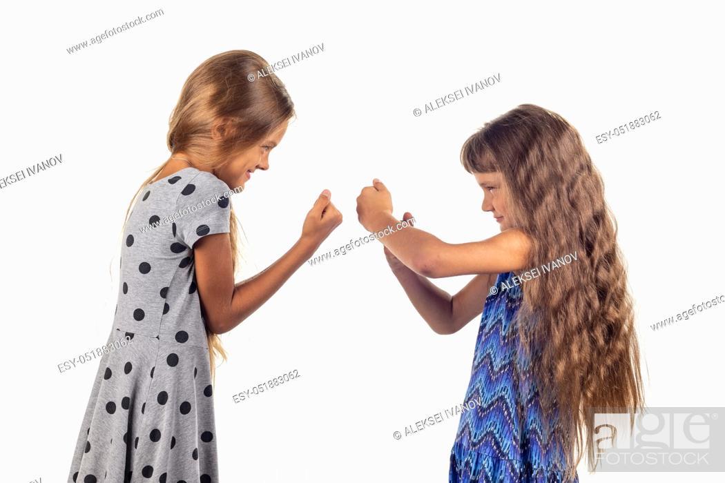 Stock Photo: Two girls are fighting, studio white background.
