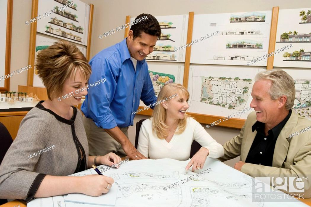 Stock Photo: Two women meeting with architect and developer.
