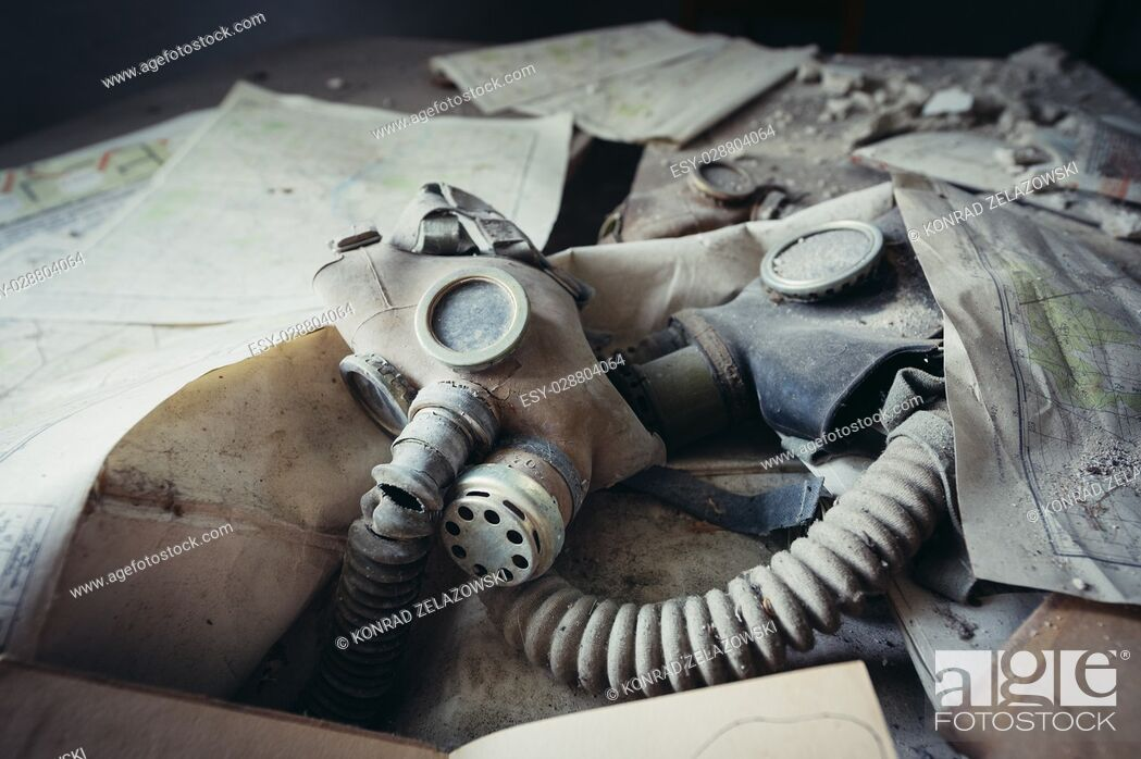 Stock Photo: Gas mask in secondary school in Mashevo abandoned village of Chernobyl Nuclear Power Plant Zone of Alienation around nuclear reactor disaster, Ukraine.