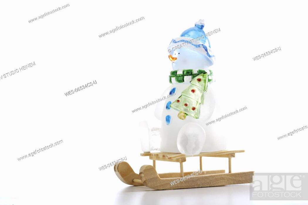 Stock Photo: Toy snowman on sledge, close-up.