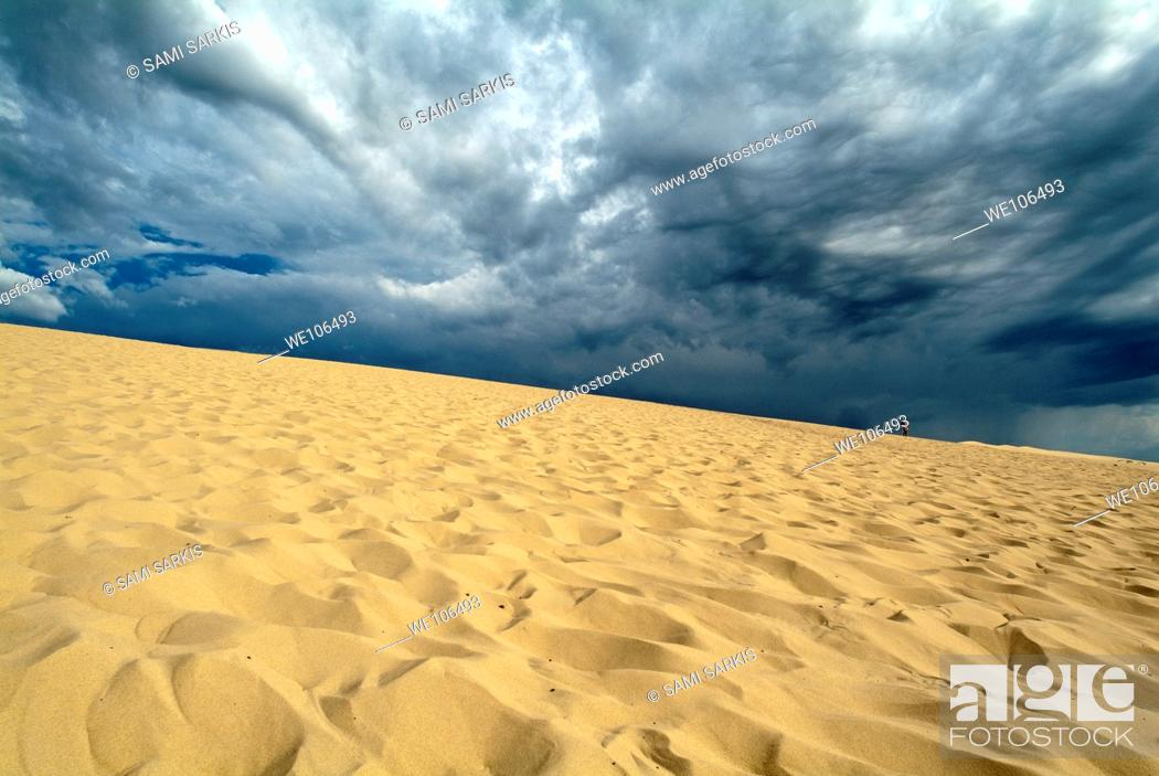 Stock Photo: Clouds over the Great Dune of Pyla on the Bassin d'Arcachon, France.