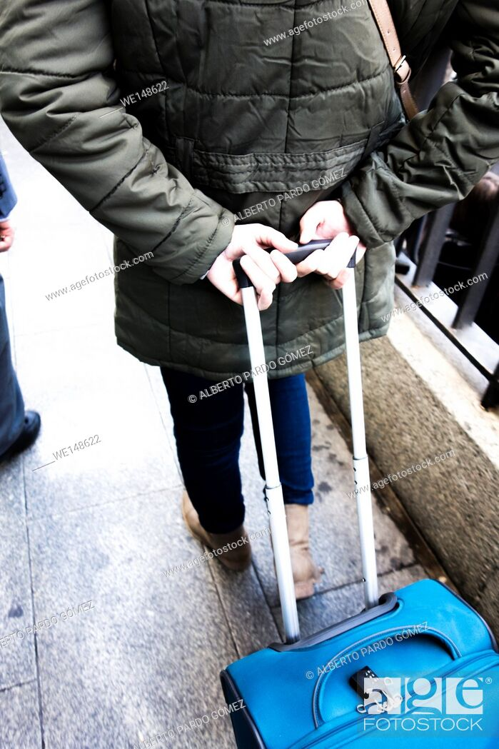Stock Photo: Person walking with trolley in madrid, Spain.