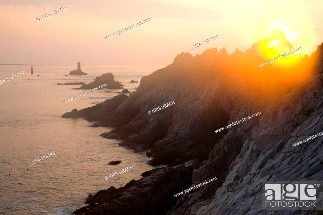 Stock Photo: SUNSET AT POINTE DU RAZ. FINISTERE. SOUTH BRITTANY. FRANCE.