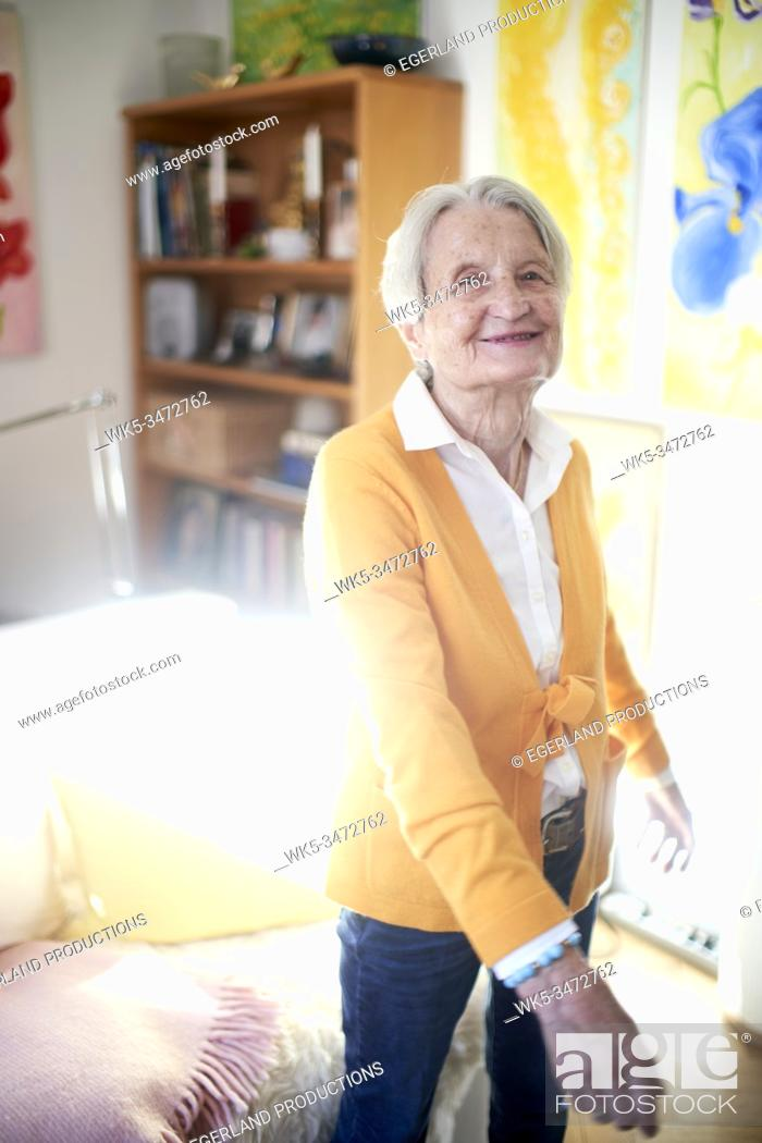 Stock Photo: Senior woman dancing at home alone.