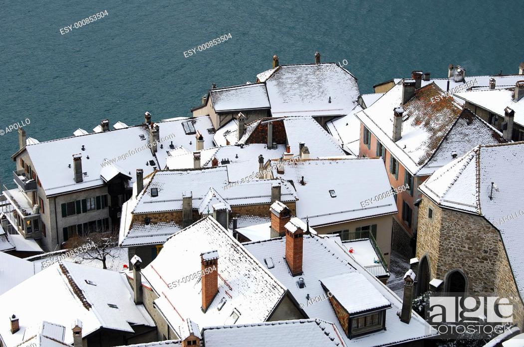 Stock Photo: Snow-covered roofs of houses in Saint-Saphorin at Lake Geneva, Lavaux, Switzerland.