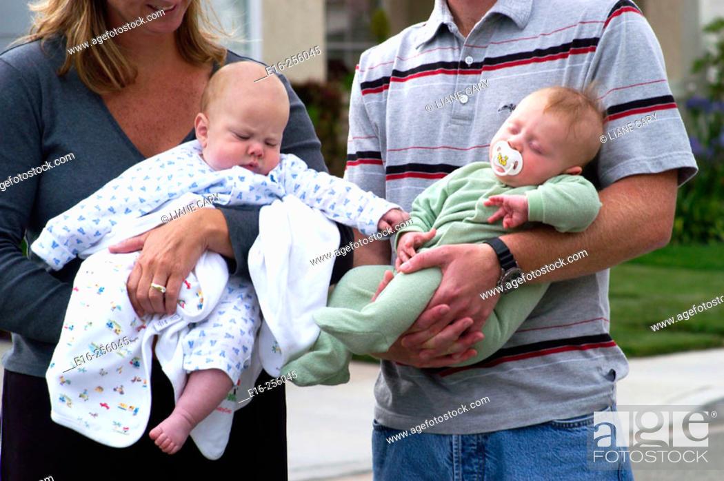 Stock Photo: holding infants.