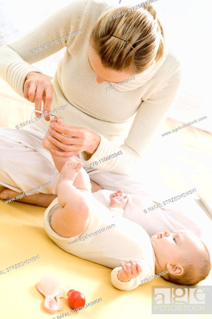 Stock Photo: mum cutting baby's nails.