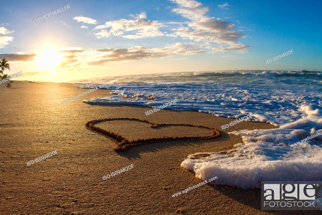 Stock Photo: Heart, drawn in sand, sunset.