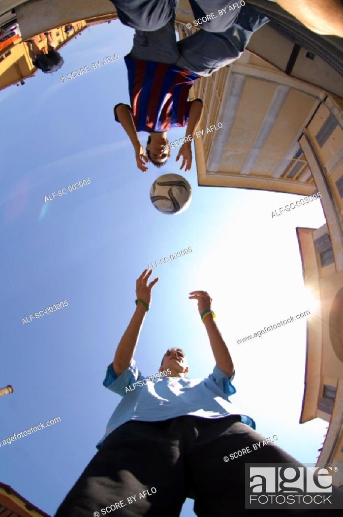 Stock Photo: Teenage boys playing with ball.