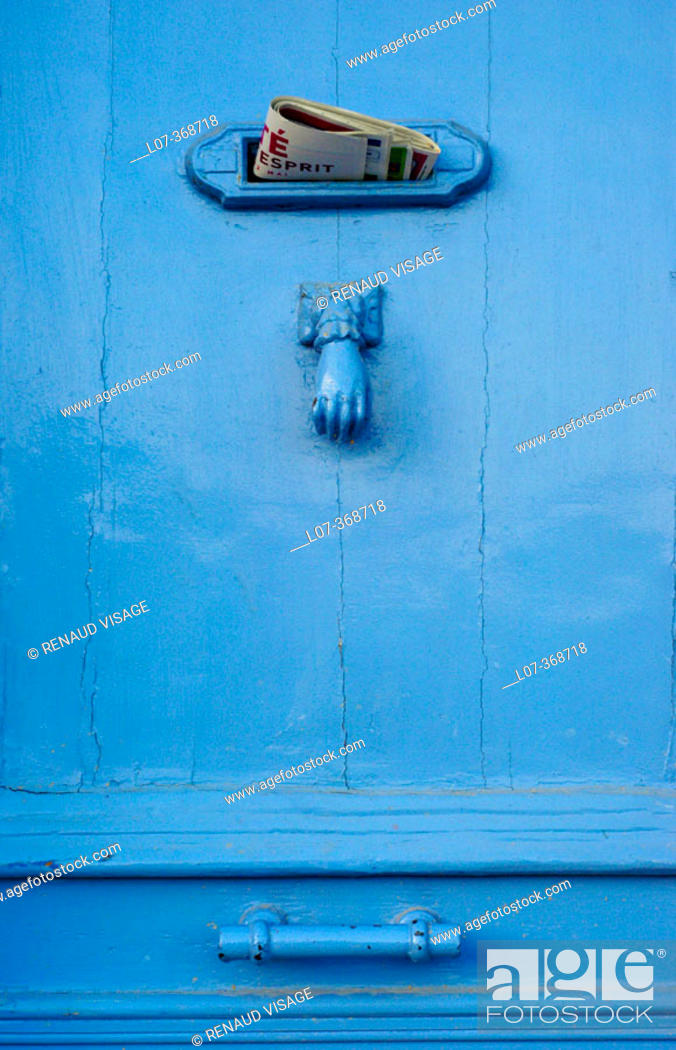 Stock Photo: Blue door with letter drop and knocker. Cassis. France.