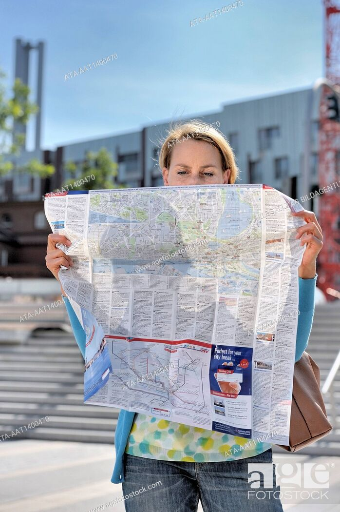 Stock Photo: Woman with a city map.