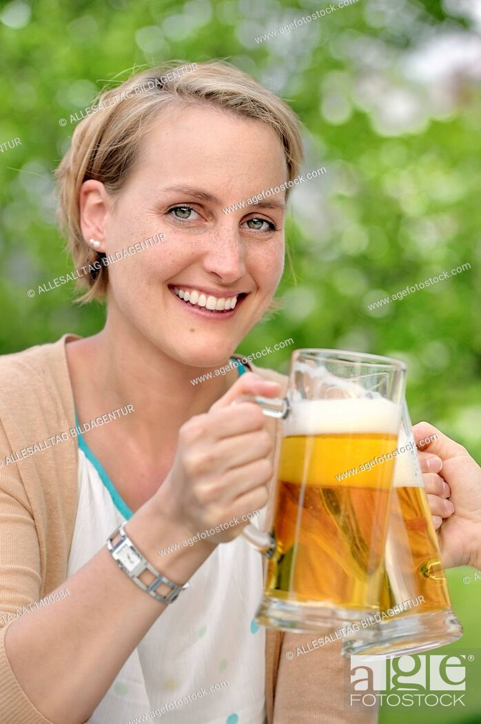 Stock Photo: Woman drinking beer.