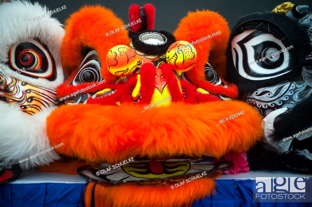 Imagen: Singapore, Republic of Singapore, Asia - Masks of costume outfits for a traditional lion dance performance are seen in front of a stage in Chinatown.