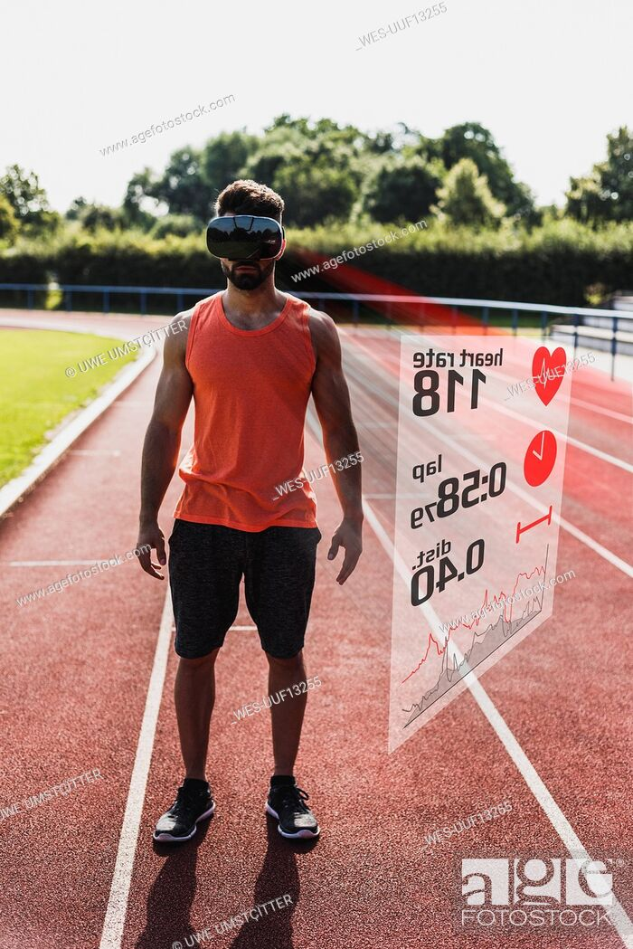 Photo de stock: Athlete on tartan track wearing VR glasses surrounded by data.