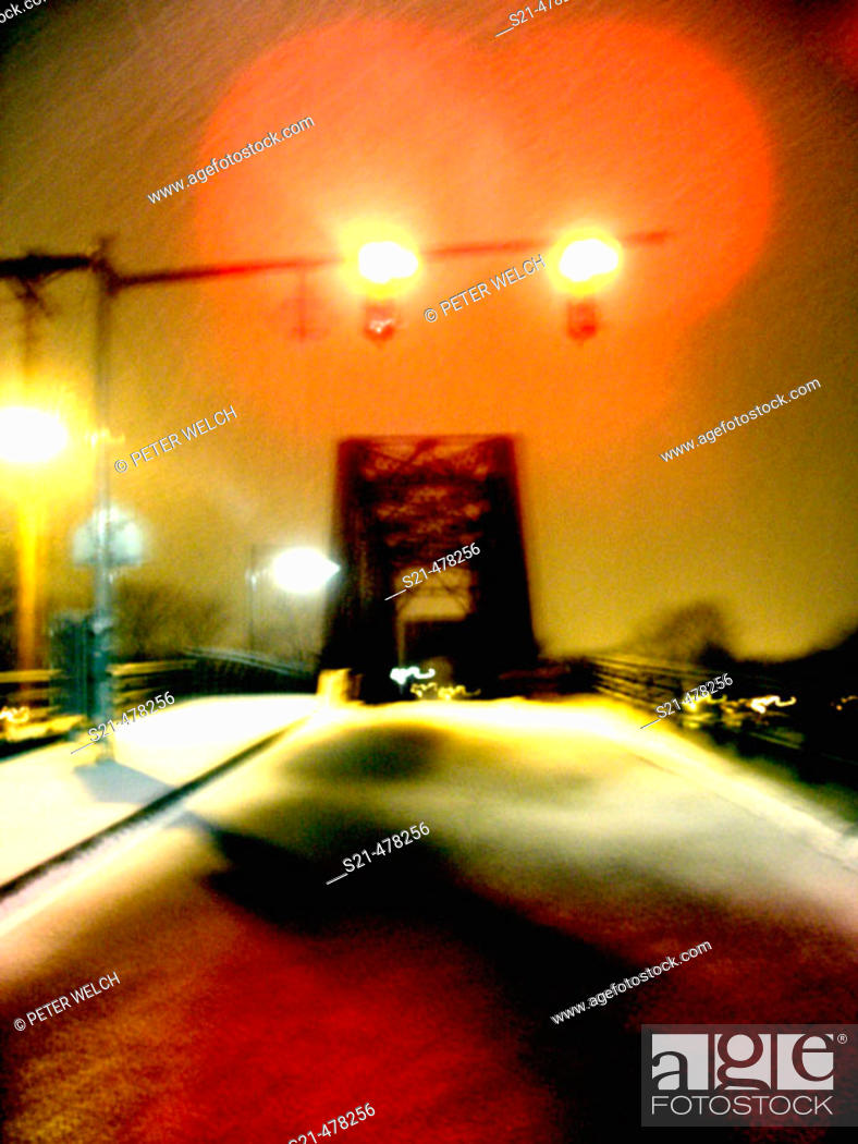 Stock Photo: A train trestle is captured at night during the winter with fresh fallen snow.  Ghostly and mysterious.