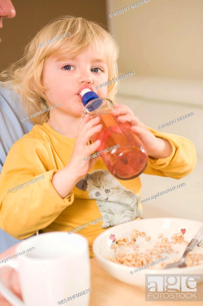 Stock Photo: Girl drinking water in breakfast.