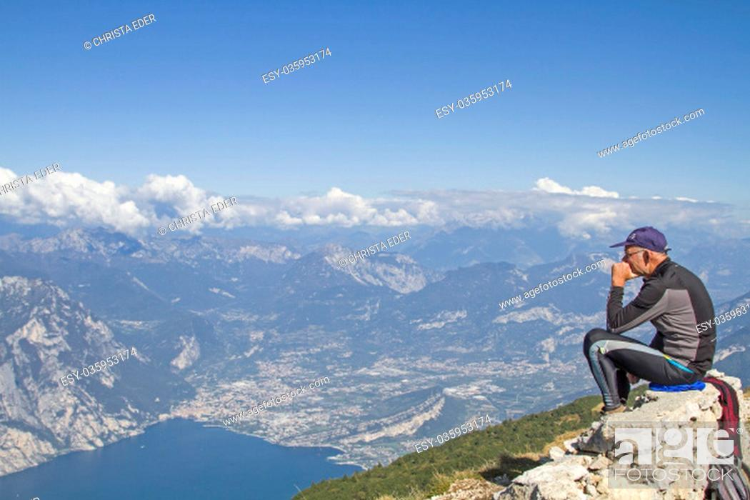Stock Photo: mountain bikers enjoy after their driveway to the altissimo the magnificent view of lake garda.