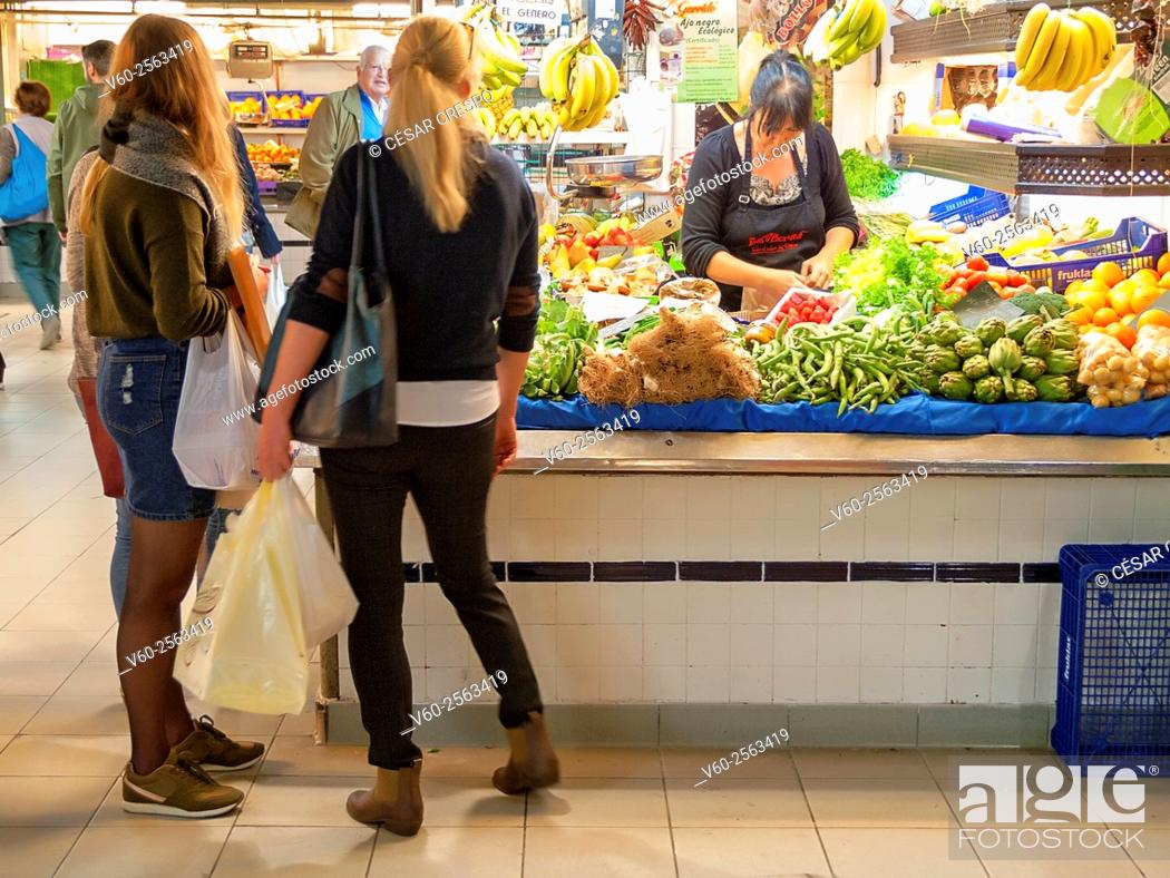 Stock Photo: -Young Women Shopping in Market- Alicante Spain.