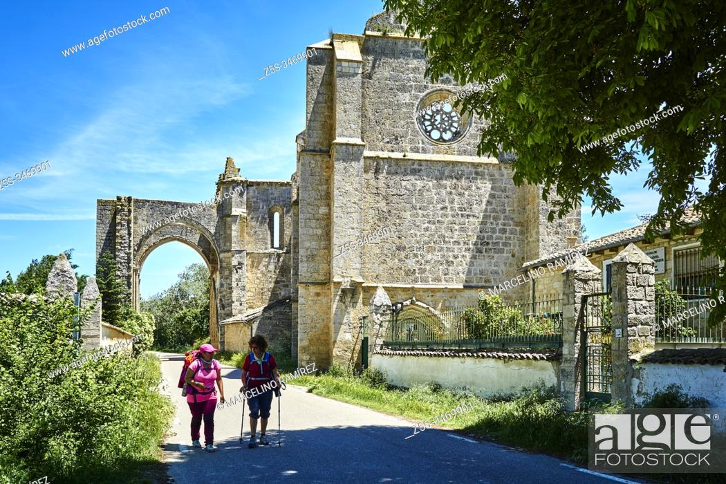 Stock Photo: Pilgrims with backpack walking next to the ruins of the Convent of San Anton. French Way, Way of St. James. Castrojeriz, Burgos, Castile and Leon, Spain, Europe.