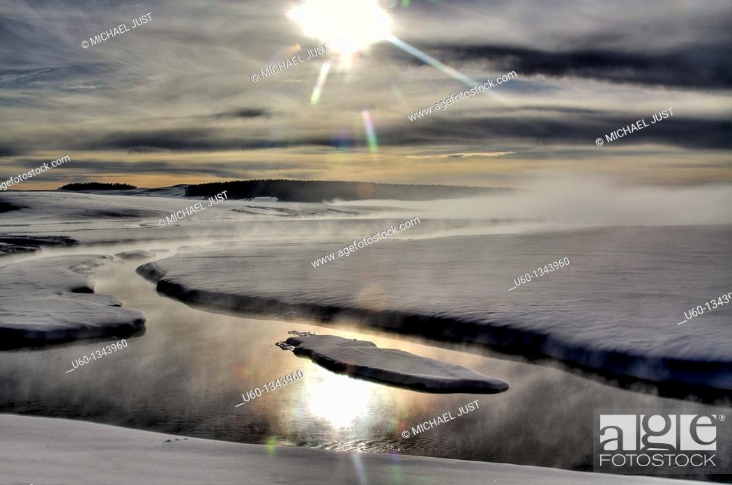 Stock Photo: Steam and sun surround Alum Creek in the Hayden Valley at Yellowstone National Park,Wyoming.