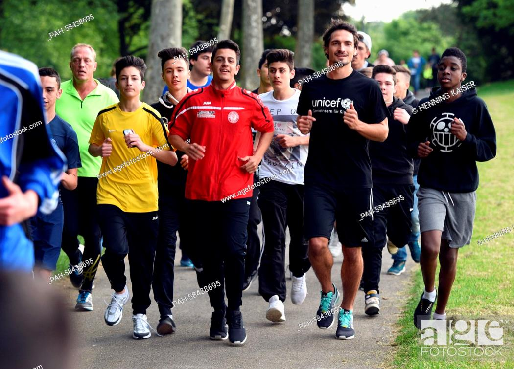 Stock Photo: Soccer world champion Mats Hummels participates in a charity run of the United Nations Children's Fund UNICEF with children of the Henry Ford secondary school.