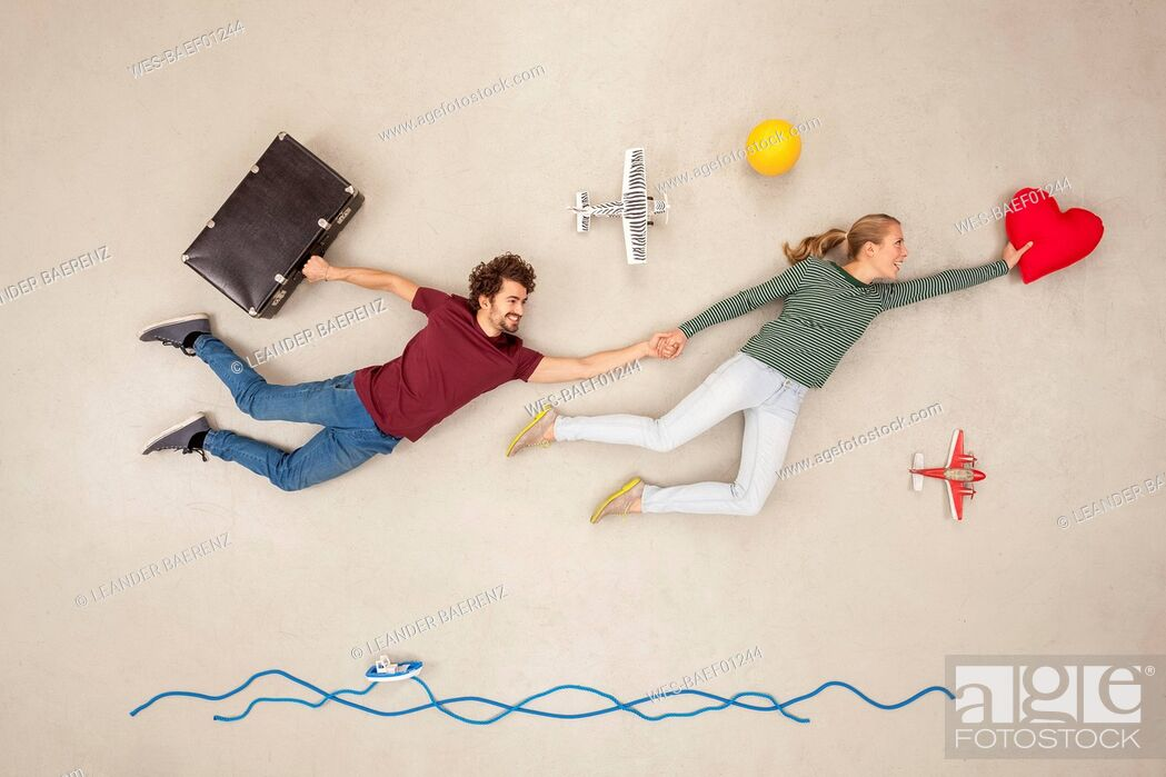 Stock Photo: Happy couple flying together for holidays.