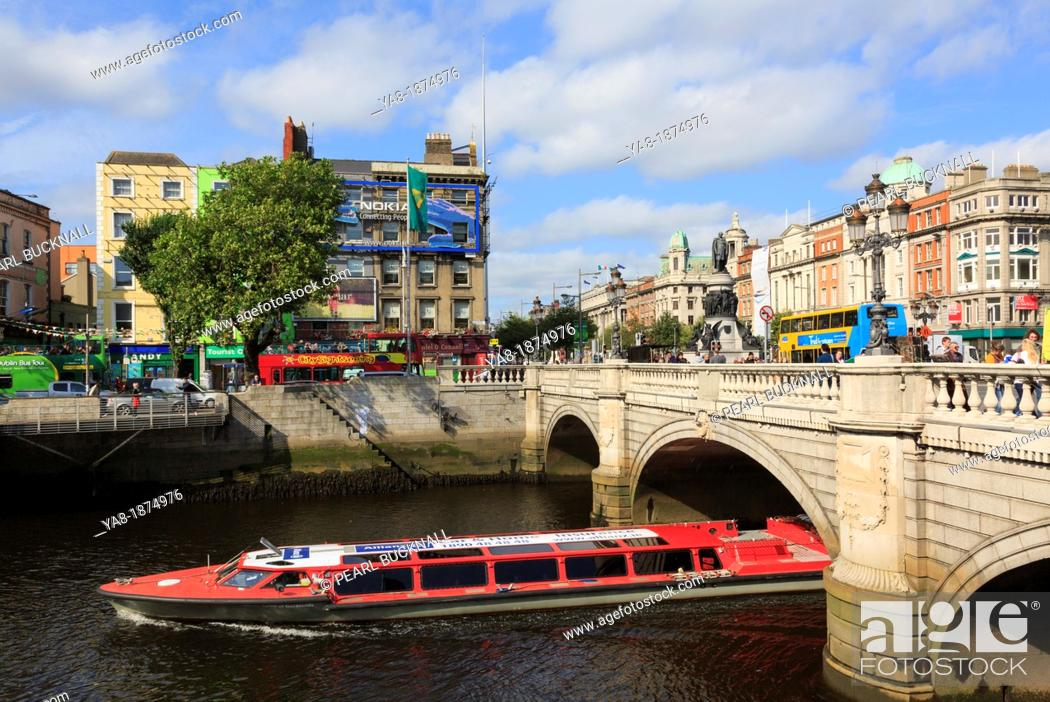 Stock Photo: Aston Quay, Dublin, Republic of Ireland, Eire, Europe  Sightseeing cruise boat passing under the O'Connell Bridge on the River Liffey.