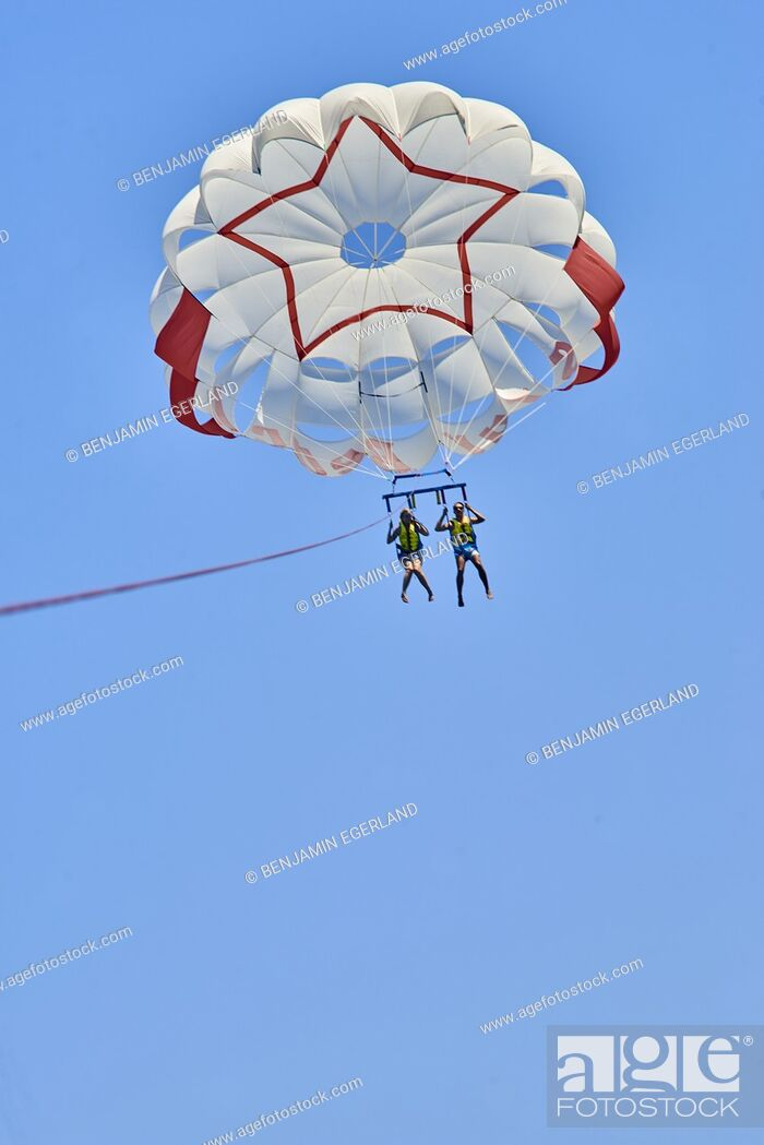 Stock Photo: Couple during parasailing. Chersonissos. Crete, Greece.