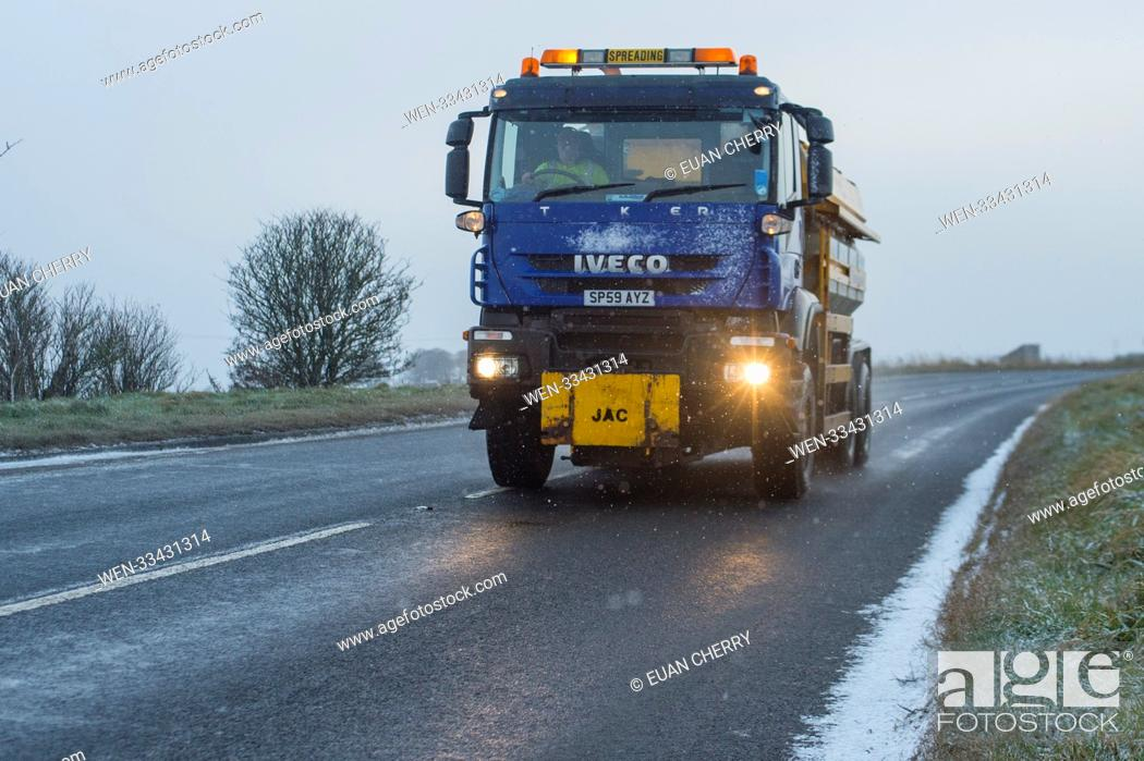 Stock Photo: Northern Scotland is hit by snow fall and below freezing temperatures as snow arrives as far south as Montrose Featuring: gritter Where: Montrose.