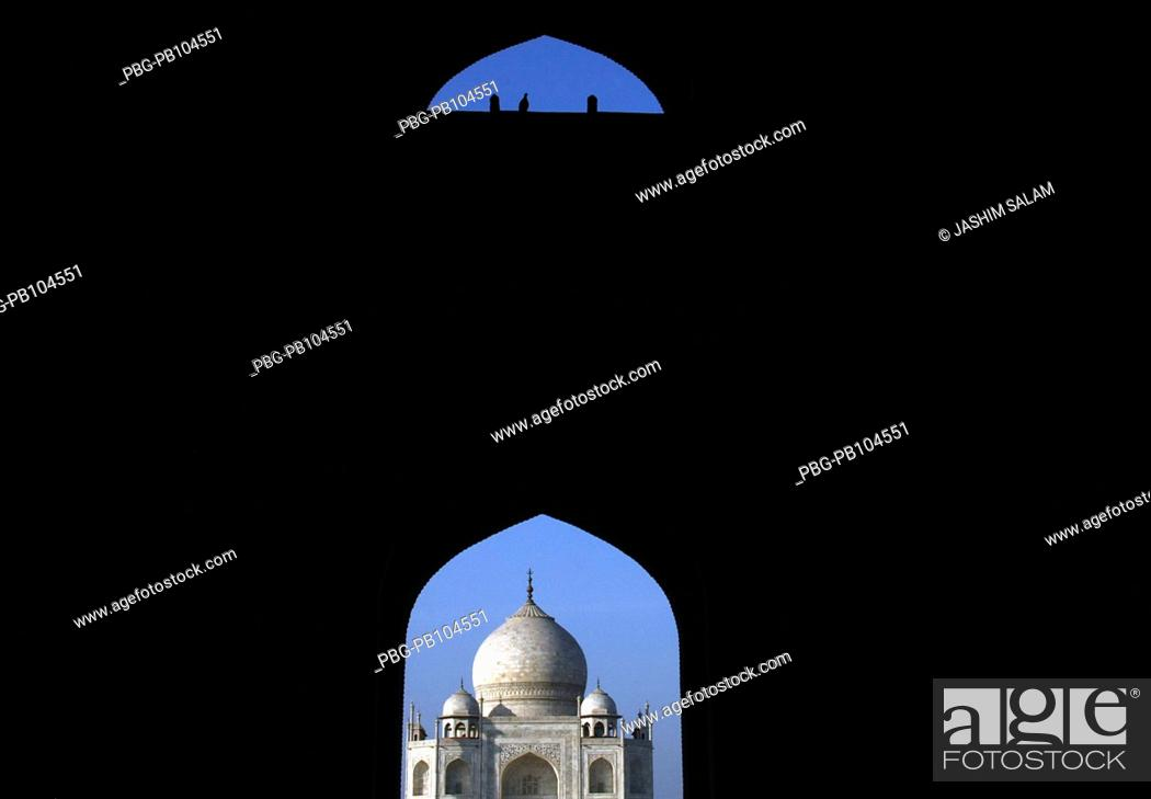 Stock Photo: Taj Mahal seen from main entrance gate where some pigeon resting The Taj Mahal sometimes called 'the Taj' was built by Emperor Shah Jahan in memory of his wife.