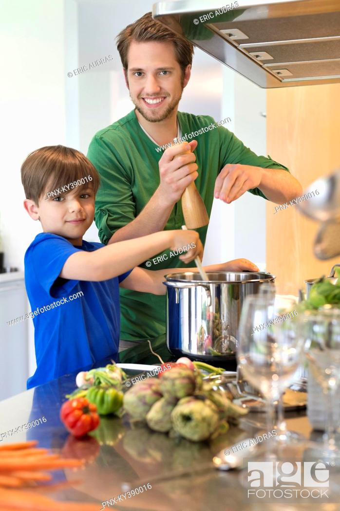 Stock Photo: Boy assisting his father in the kitchen.