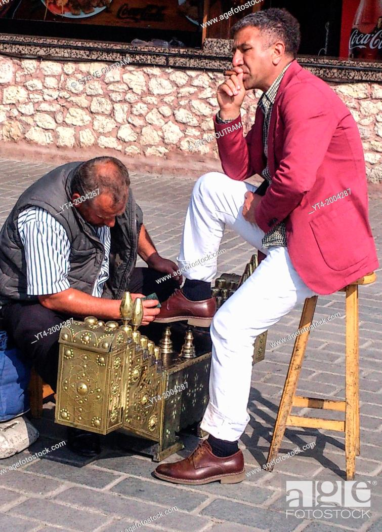 Stock Photo: Man having his Shoes cleaned, Istanbul, Turkey.