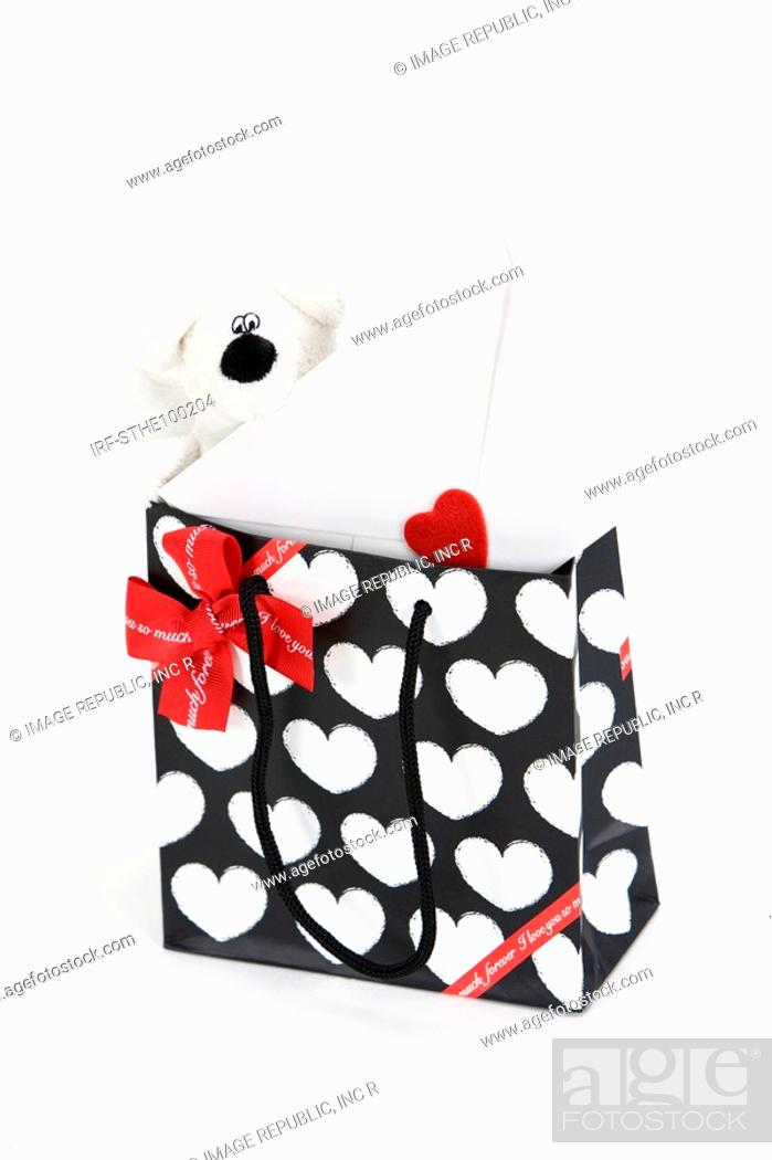 Stock Photo: doll and envelope in shopping bag.