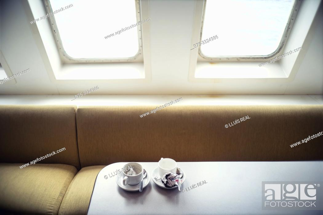 Stock Photo: Two empty coffee cups on the dining table of a boat. Mediterranean Sea, Spain, Europe.