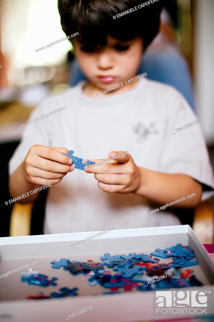 Stock Photo: Child plays with puzle.